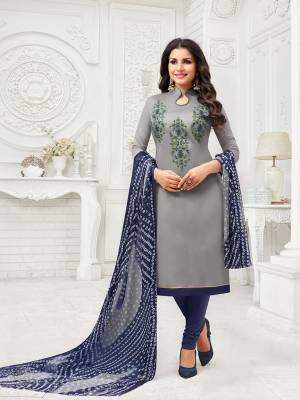 Flaunt Your Rich And Elegant Taste Wearing This Designer Suit In Grey Colored Top Paired With Navy Blue Colored Bottom And Grey And Navy Blue Colored Dupatta. Its Thread Embroidered Top Is Fabricated On Modal Silk Paired With Cotton Bottom And Chiffon Fabricated Dupatta.