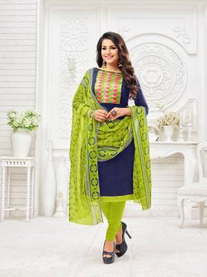 Enhance Your Personality Wearing This Dress Material In Navy Blue Colored Top Paired with Contrasting Parrot Green Colored Bottom And Dupatta, Its Top Is Fabricated On Modal Silk Paired With Cotton Bottom And Chiffon Fabricated Dupatta.