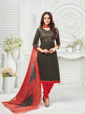 Flaunt Your Rich And Elegant Taste Wearing This Designer Suit In Dark Grey Colored Top Paired With Red Colored Bottom And Dupatta. Its Thread Embroidered Top Is Fabricated On Modal Silk Paired With Cotton Bottom And Chiffon Fabricated Dupatta.
