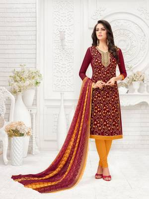 Here Is A Proper Traditional Color Pallete With This Designer Dress Material In Maroon Colored Top Paired With Contrasting Musturd Yellow Colored Bottom And Maroon & Yellow Colored  Dupatta. Its Top Is Fabricated On Modal Silk Paired With Cotton Bottom And Chiffon Printed Dupatta.