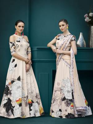 Get Ready For The Upcoming Festive And Wedding Season With This Designer Two One Lehenga Choli Cum Gown. This Designer Lehenga Choli Is Fabricated On Spandex Silk Beautified With Bold Floral Prints And Stone Work Paired With Chiffon Fabricated Dupatta.