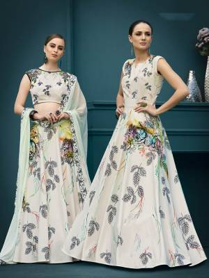 For A Girly Trendy Look, Grab This Designer Two In One Lehenga Choli Which You Can Also Make It As Gown. This Lehenga Choli Is Fabricated On Spandex Silk Paired With Chiffon Fabricated Dupatta. It Is Beautified With Bold Floral Prints And Stone Work. Its Fabric Has Strech Which Ensures Superb Comfort Throughtout The Gala.