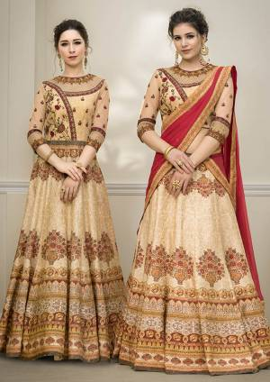 Grab This Beautiful Designer Two In One Lehenga Choli Cum Gown In Beige Color. You Can Get This Stitched As A Lehenga Or Floor Length Gown As Per Your Occasion And Convenience. Its Blouse Are Lehenga Are Fabricated On Banarasi Art Silk Beautified With Digital Prints And Embroidery Paired With Chiffon Fabricated Dupatta. Buy This Heavy Designer Piece Now.