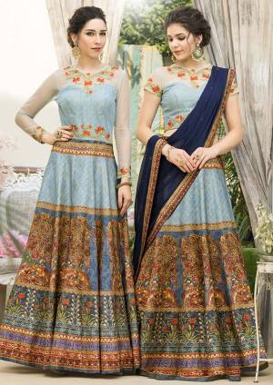 Grab This Beautiful Designer Two In One Lehenga Choli Cum Gown In Sky Blue Color. You Can Get This Stitched As A Lehenga Or Floor Length Gown As Per Your Occasion And Convenience. Its Blouse Are Lehenga Are Fabricated On Banarasi Art Silk Beautified With Digital Prints And Embroidery Paired With Chiffon Fabricated Dupatta. Buy This Heavy Designer Piece Now.