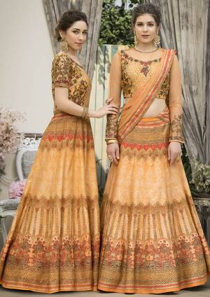 Grab This Beautiful Designer Two In One Lehenga Choli Cum Gown In Musturd Yellow Color. You Can Get This Stitched As A Lehenga Or Floor Length Gown As Per Your Occasion And Convenience. Its Blouse Are Lehenga Are Fabricated On Banarasi Art Silk Beautified With Digital Prints And Embroidery Paired With Chiffon Fabricated Dupatta. Buy This Heavy Designer Piece Now.