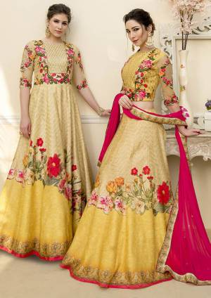 Grab This Beautiful Designer Two In One Lehenga Choli Cum Gown In Yellow Color. You Can Get This Stitched As A Lehenga Or Floor Length Gown As Per Your Occasion And Convenience. Its Blouse Are Lehenga Are Fabricated On Banarasi Art Silk Beautified With Digital Prints And Embroidery Paired With Chiffon Fabricated Dupatta. Buy This Heavy Designer Piece Now.