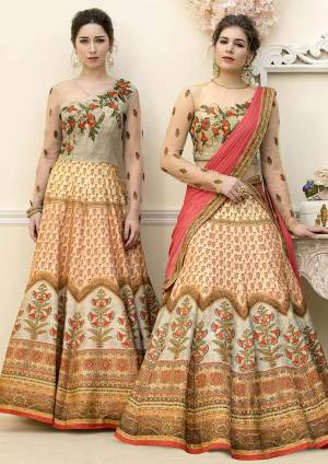 Grab This Beautiful Designer Two In One Lehenga Choli Cum Gown In Grey And  Beige Color. You Can Get This Stitched As A Lehenga Or Floor Length Gown As Per Your Occasion And Convenience. Its Blouse Are Lehenga Are Fabricated On Banarasi Art Silk Beautified With Digital Prints And Embroidery Paired With Chiffon Fabricated Dupatta. Buy This Heavy Designer Piece Now.