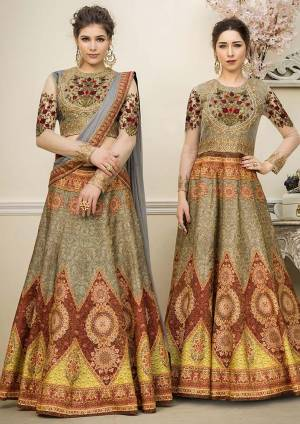 Grab This Beautiful Designer Two In One Lehenga Choli Cum Gown In Olive Green Color. You Can Get This Stitched As A Lehenga Or Floor Length Gown As Per Your Occasion And Convenience. Its Blouse Are Lehenga Are Fabricated On Banarasi Art Silk Beautified With Digital Prints And Embroidery Paired With Chiffon Fabricated Dupatta. Buy This Heavy Designer Piece Now.
