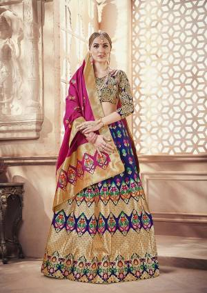 Celebrate This Festive Season with Beauty And Comfort Wearing this Designer Silk Based Lehenga Choli In Multi Colored Blouse Paired With Royal Blue Colored Lehenga And Dark Pink Colored Dupatta. It Is Beautified With Weave All Over.