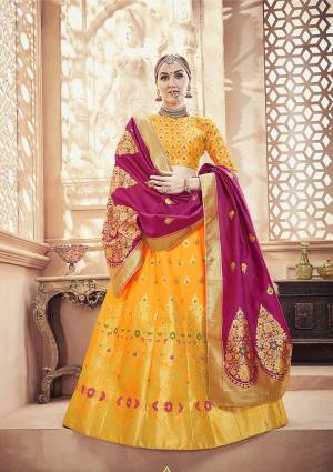 Catch All The Limelight At The Next Function You Attend With This Designer Lehenga Choli In Yellow Color Paired With Contrasting Magenta Pink Colored Dupatta. This Whole Attire Is Fabricated On Banarasi Art Silk Beautified With Attractive Weave All Over.