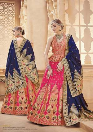 Shine Bright Wearing This Designer Silk Based Lehenga Choli In Dark Pink Color Paired With Contrasting Navy Blue Colored Dupatta. It Is Fabricated On Banarasi Art Silk Which Gives A Rich Look To Your Personality.