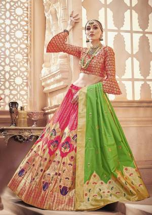 Shine Bright Wearing This Designer Silk Based Lehenga Choli In Dark Pink Color Paired With Contrasting Green Colored Dupatta. It Is Fabricated On Banarasi Art Silk Which Gives A Rich Look To Your Personality.