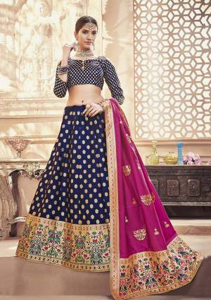 Enhance Your Personality Wearing This Designer Silk Based Lehenga Choli In Navy Blue Color Paired With Magenta Pink Colored Dupatta. This Lehenga Choli And Dupatta are Fabricated On Banarasi Art Silk Beautified With Weave All Over. Buy Now.