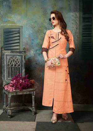 Celebrate This Festive Season With Beauty And Comfort Wearing This Designer Readymade Kurti In Orange Color Fabricated On Khadi Cotton. It Is Beautified With Thread Work Has Assymetric Pattern.