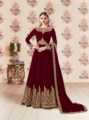 Add This Beautiful Designer Floor Length Suit To Your Wardrobe In Maroon Color Paired With Maroon Colored Bottom And Dupatta. Its Heavy Embroidered Top Is Fabricated On Georgette Paired With Santoon bottom And Georgette Fabricated Dupatta. Buy Now.
