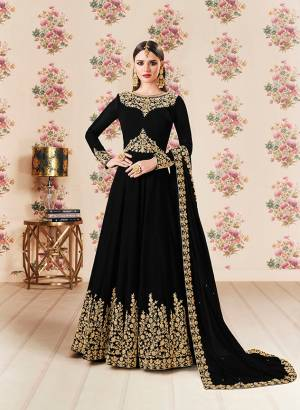 Add This Beautiful Designer Floor Length Suit To Your Wardrobe In Black Color Paired With Black Colored Bottom And Dupatta. Its Heavy Embroidered Top Is Fabricated On Georgette Paired With Santoon bottom And Georgette Fabricated Dupatta. Buy Now.