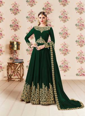 Add This Beautiful Designer Floor Length Suit To Your Wardrobe In Dark Green Color Paired With Dark Green Colored Bottom And Dupatta. Its Heavy Embroidered Top Is Fabricated On Georgette Paired With Santoon bottom And Georgette Fabricated Dupatta. Buy Now.