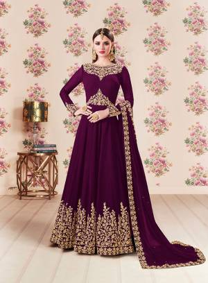 Add This Beautiful Designer Floor Length Suit To Your Wardrobe In Wine Color Paired With Wine Colored Bottom And Dupatta. Its Heavy Embroidered Top Is Fabricated On Georgette Paired With Santoon bottom And Georgette Fabricated Dupatta. Buy Now.
