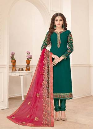 Here Is A Very Beautiful Designer Straight Suit In Teal Green Paired With Contrasting Dark Pink Colored Dupatta. Its Top Is Fabricated On Georgette Paired With Santoon Bottom And Georgette Fabricated Dupatta. Its Top And Dupatta Are Beautified With Heavy Embroidery Giving It An Attractive Look.