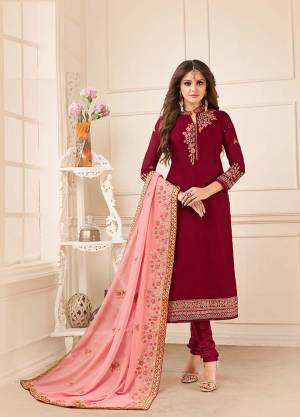 Grab This Royal Looking Heavy Designer Straight Suit In Maroon Color Paired With Contrasting Peach Colored Dupatta. Its Embroidered Top Is Fabricated On Satin Georgette Paired With Santoon Bottom And Georgette Fabricated Dupatta. Buy Now.