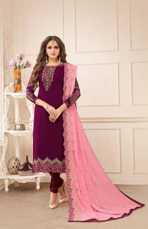 Add This Very Pretty Designer Straight Suit To Your Wardrobe In Purple Color Paired With Contrasting Pink Colored Dupatta. Its Embroidered Top And Dupatta Are Fabricated On Georgette Paired With Santoon Bottom. It Has Pretty Embroidery Giving It An elegant Look.