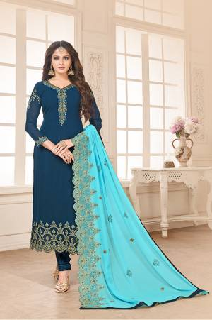 Go with The Shades Of Blue With This Designer Straight Cut Suit In Blue Color Paired With Sky Blue Colored Dupatta. Its Top And Dupatta Are Fabricated On Georgette Paired With Santoon Bottom. Its Heavy Embroidery Over The Top And Dupatta Is Giving This Dress An Enhanced Look.