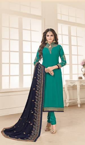 Go with The Shades Of Blue With This Designer Straight Cut Suit In Turquoise Blue Color Paired With Navy Blue Colored Dupatta. Its Top And Dupatta Are Fabricated On Georgette Paired With Santoon Bottom. Its Heavy Embroidery Over The Top And Dupatta Is Giving This Dress An Enhanced Look.