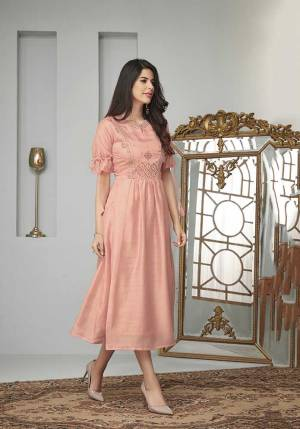 Look Pretty And Earn Lots Of Compliments Wearing This Readymade Designer Kurti In Peach Color Fabricated On Cotton Slub. It Is Beautified With Contrasting Thread Work Over The Yoke. Also It Is Available In All Regular Sizes.