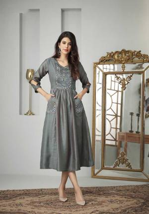 Add This Beautiful Designer Readymade Kurti To Your Wardrobe In Dark Grey Color Fabricated On Cotton Slub. This Kurti Is Beautified With Thread Work And Available In All Regular Sizes.