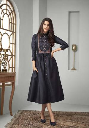 Enhance Your Personality Wearing This Designer Readymade Kurti In Navy Blue Color Fabricated On Cotton Slub. It Is Beautified With Contrasting Thread Work Over The Yoke And Available In All Regular Sizes.