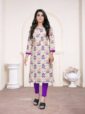 Simple Kurti Is Here For Your Casual Wear In White And Purple Color Fabricated On Cotton. It Is Beautified With Prints and Available In All Regular Sizes.