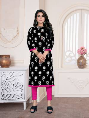Add Some Casuals With This Readymade Straight Kurti In Black Color Fabricated On Cotton Beautified With All Over Prints