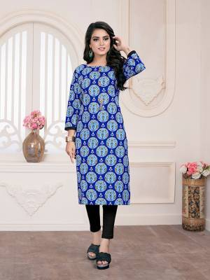 Simple Kurti Is Here For Your Casual Wear In Blue Color Fabricated On Cotton. It Is Beautified With Prints and Available In All Regular Sizes.
