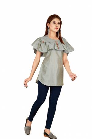 Rich And Elegant Looking Readymade Top Is Here In Grey Color Fabricated On Art Silk. This Pretty Top Looks Best With Blue Or Black Colored Denim. Buy Now.