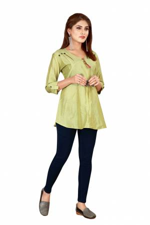 Grab This Pretty Simple Readymade Top In Pear Green Color Fabricated On Art Silk. You Can Pair This Up With Denim Or Pants. Buy Now.