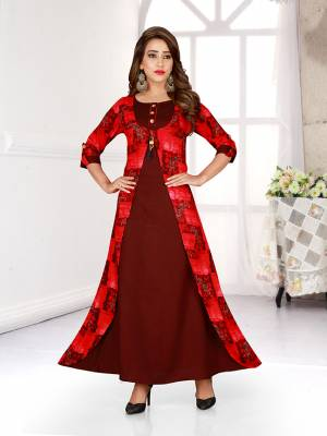 Grab This Pretty Readymade Gown For Your Semi-Casuals In Maroon And Red Color Fabricated On Rayon. It Has Printed Jacket Pattern And Available In All Regular Sizes. Buy Now.