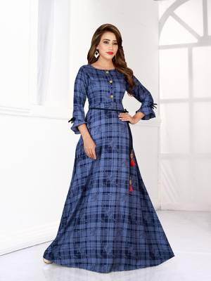 Look Pretty In This Designer Readymade Gown In Blue Color. This Gown Is Fabricated On Rayon Beautified With Checks And Floral Prints All Over It.