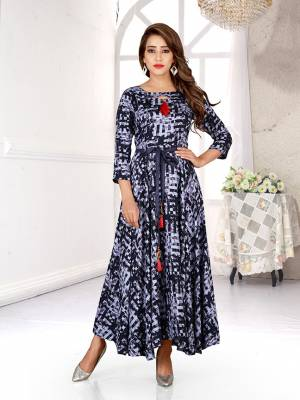 Simple And Elegant Looking Readymade Gown Is Here In Shades Of Grey. This Pretty Gown Is Fabricated On Rayon Beautified With All Over Prints.