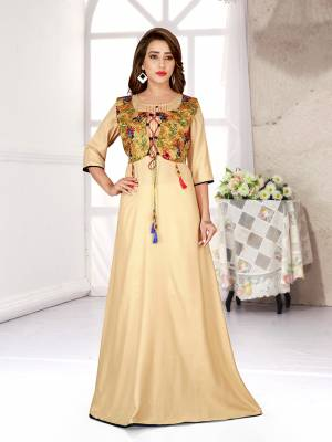 Celebrate This Festive Season With Beauty And Comfort Wearing This Designer Readymade Gown In Beige Color Fabricated On Rayon.