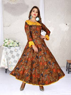 Look Pretty In This Designer Readymade Gown In Brown Color. This Gown Is Fabricated On Rayon Beautified With Abstract Prints All Over It.