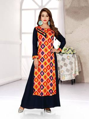 Go Colorful With This Readymade Gown In Multi And Blue Color Fabricated Rayon. This Gown Is Beautified With Prints All Over And Has A Trendy Double Layer Pattern. Buy Now.