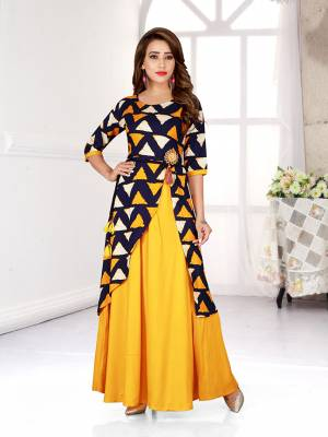 Celebrate This Festive Season With Beauty And Comfort Wearing This Designer Readymade Gown In Yellow And Navy Blue Color Fabricated On Rayon.