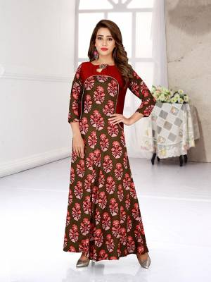 Simple And Elegant Looking Readymade Gown Is Here In Olive Green And Red This Pretty Gown Is Fabricated On Rayon Beautified With All Over Prints.