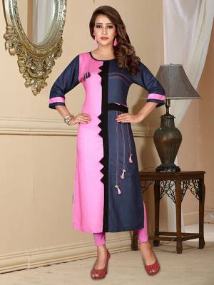 Grab This Readymade Pretty Kurti In Pink And Navy Blue Color Fabricated On Rayon. It Is Light In Weight And Can Be Paired With Either Of The Colored Leggings Or Pants.