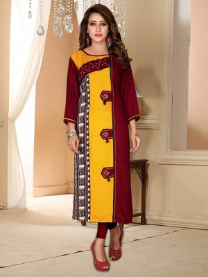 For Your Semi-Casuals, Grab This Simple Readymade Kurti In Maroon And Yellow Color Fabricated On Rayon.