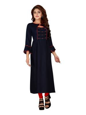 Grab This Readymade Pretty Kurti In Navy Blue Color Fabricated On Rayon. It Is Light In Weight And Can Be Paired With Same Or Contrasting  Colored Leggings Or Pants.