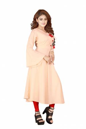 Look Pretty In This Designer Readymade Straight Kurti In Peach Color Fabricated on Rayon. It Is Light In Weight And Easy To Carry All Day Long.