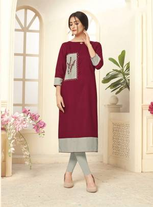 Grab This Pretty Maroon Colored Readymade Kurti Fabricated On Cotton Slub. It Is Beautified With Contrasting Patch With Thread Work. You Can Pair This Up With Same or Contrasting Colored Leggings.