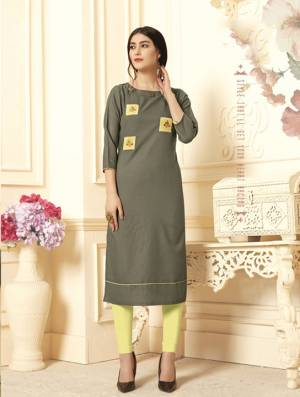 For Your Semi-Casuals, Grab This Readymade Kurti In Olive Green Color Fabricated On Cotton Slub Beautified With Patch Work. It IS Light In Weight And Available In All Regular Sizes.