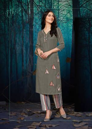 Flaunt Your Rich And Elegant Taste Wearing This Designer Readymade Pair Of Kurti And Plazzo In Grey Colored Top Paired With Multi Colored Lining Plazzo. Its Top IS Fabricated On Rayon Paired With Khadi Cotton Bottom. This Kurti Is Beautified With Applique Work With The Bottom Fabric.